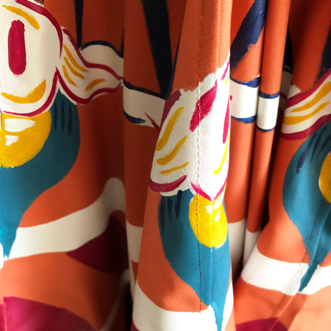 detail of a colorful patio umbrella by pearl and maude
