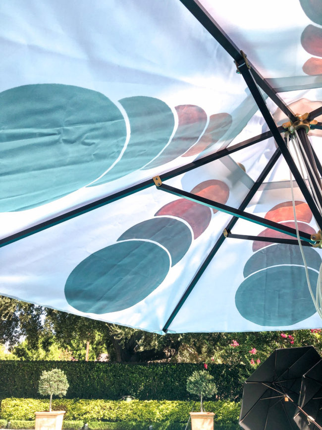 detail of a poolside custom patio umbrella