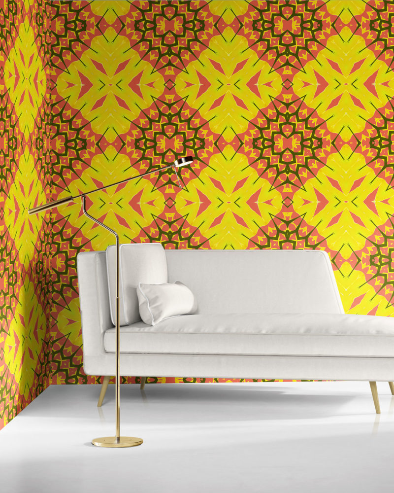 A bold, boho-chic room with white furniture and yellow and coral diamond wallpaper by Peale and Maude