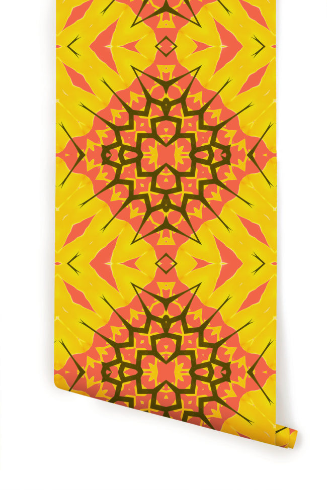 A roll of yellow diamond bohemian geometric wallpaper by Pearl and Maude