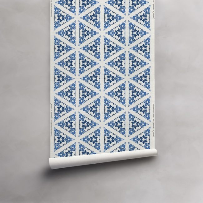 Roll of blue and white grasscloth wallpaper. Design - Bunsen by Pearl and Maude