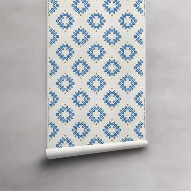 Roll of blue and white grasscloth wallcovering. Design - Emmett by Pearl and Maude