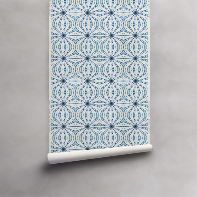 Roll of cobalt blue and white wallpaper on woven grasscloth wallcovering. Design - Fern by Pearl and Maude
