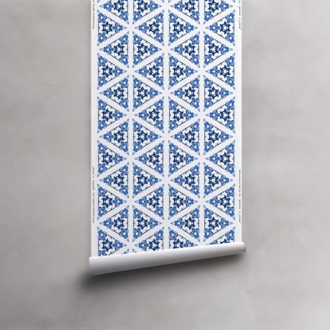 Roll of blue and white wallpaper on vellum. Design - Bunsen by Pearl and Maude