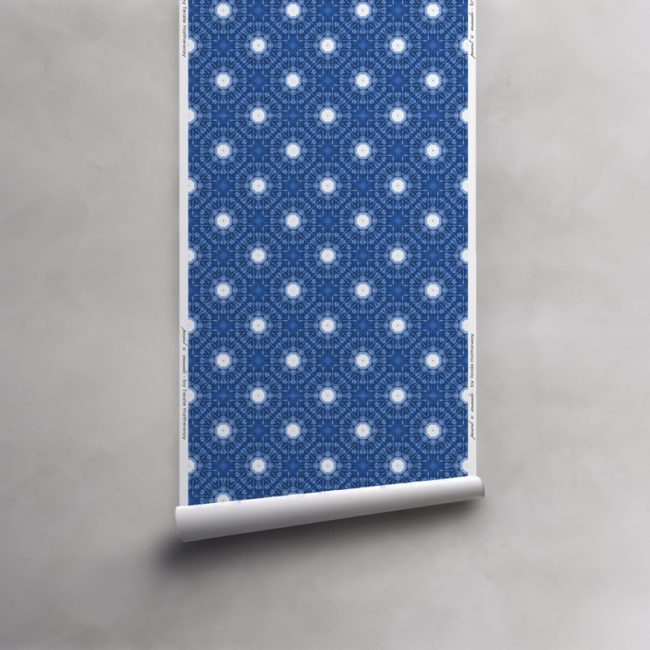Roll of indigo blue and white wallpaper on vellum. Design - Beaufort by Pearl and Maude