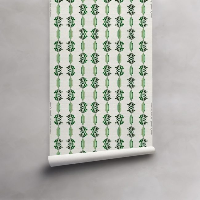 Roll of green, gold and white wallpaper on grasscloth. Design - Charlie by Pearl and Maude