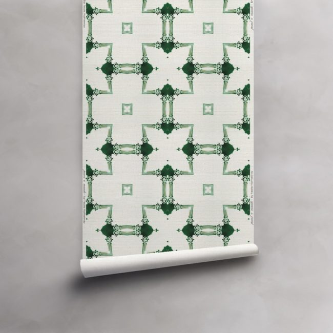 Roll of green and white wallpaper on grasscloth wallcovering. Design - Dido by Pearl and Maude