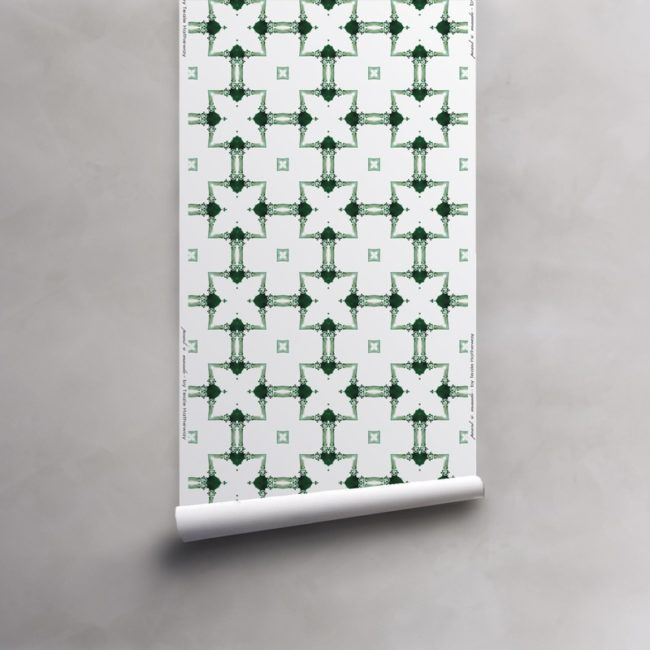 Roll of green and white wallpaper on vellum. Design - Dido by Pearl and Maude