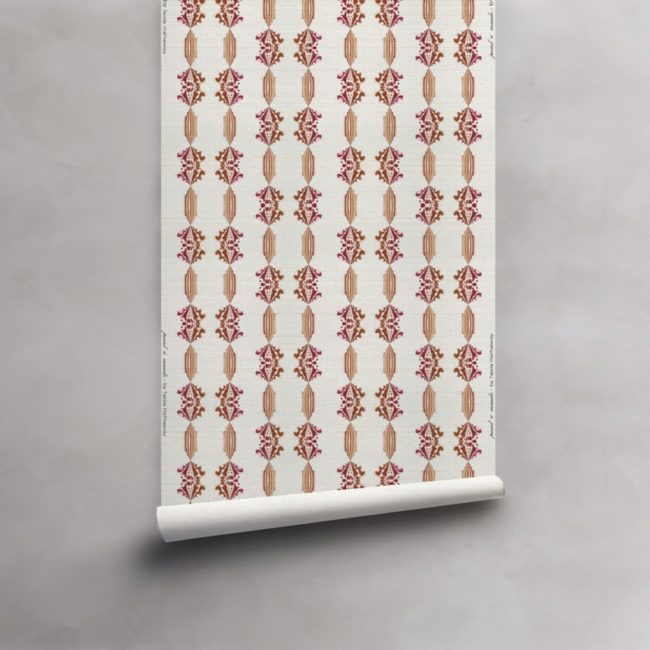 Roll of red, gold and white wallpaper on grasscloth. Design - Charlie by Pearl and Maude