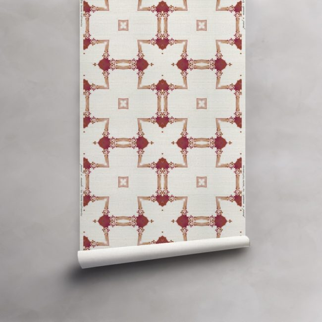 Roll of red and white wallpaper on grasscloth wallcovering. Design - Dido by Pearl and Maude