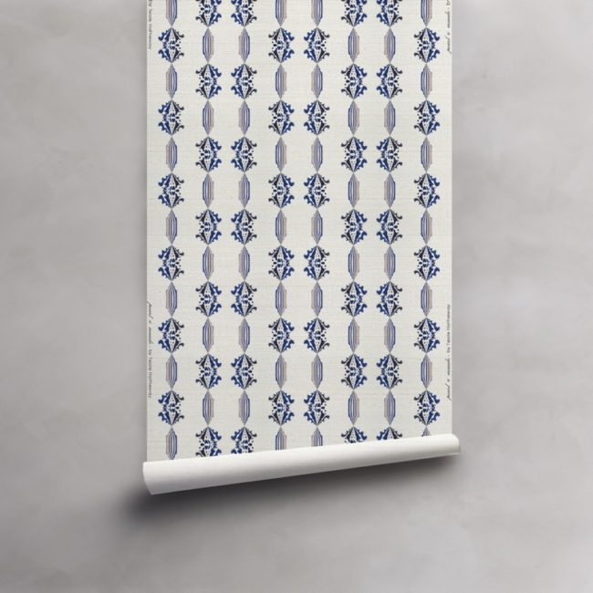 Roll of blue, gold and white wallpaper on grasscloth. Design - Charlie by Pearl and Maude