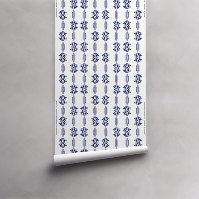 Roll of blue, gold and white wallpaper on vellum. Design - Charlie by Pearl and Maude