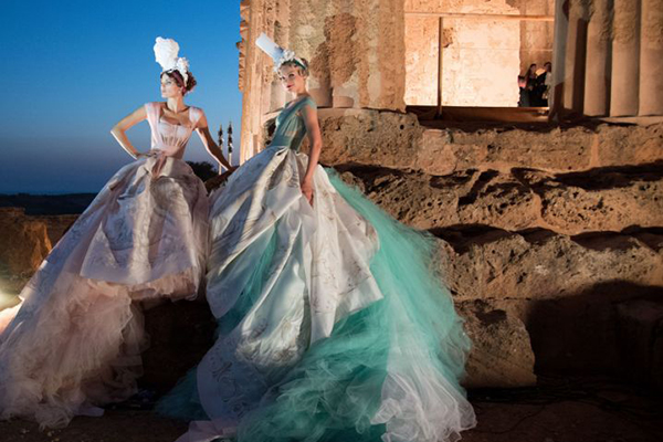 peaceful fashion show in ancient greek temple with the golden light of autumn