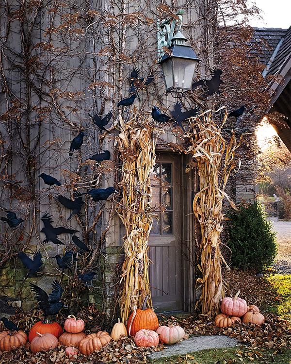 Crows, corn and pumpkins decorate the door for Halloween