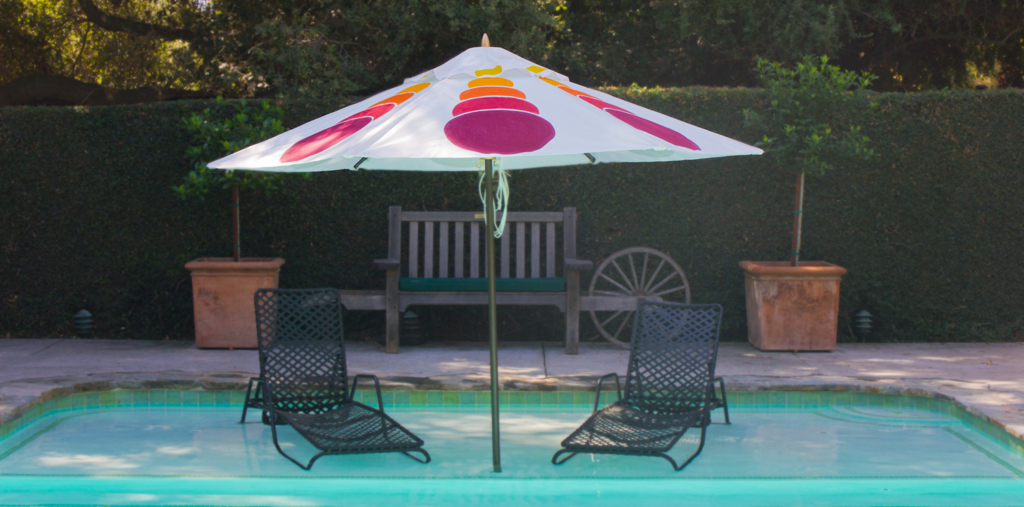 Magenta and Mustard custom patio umbrella by the pool - designed by Pearl and Maude