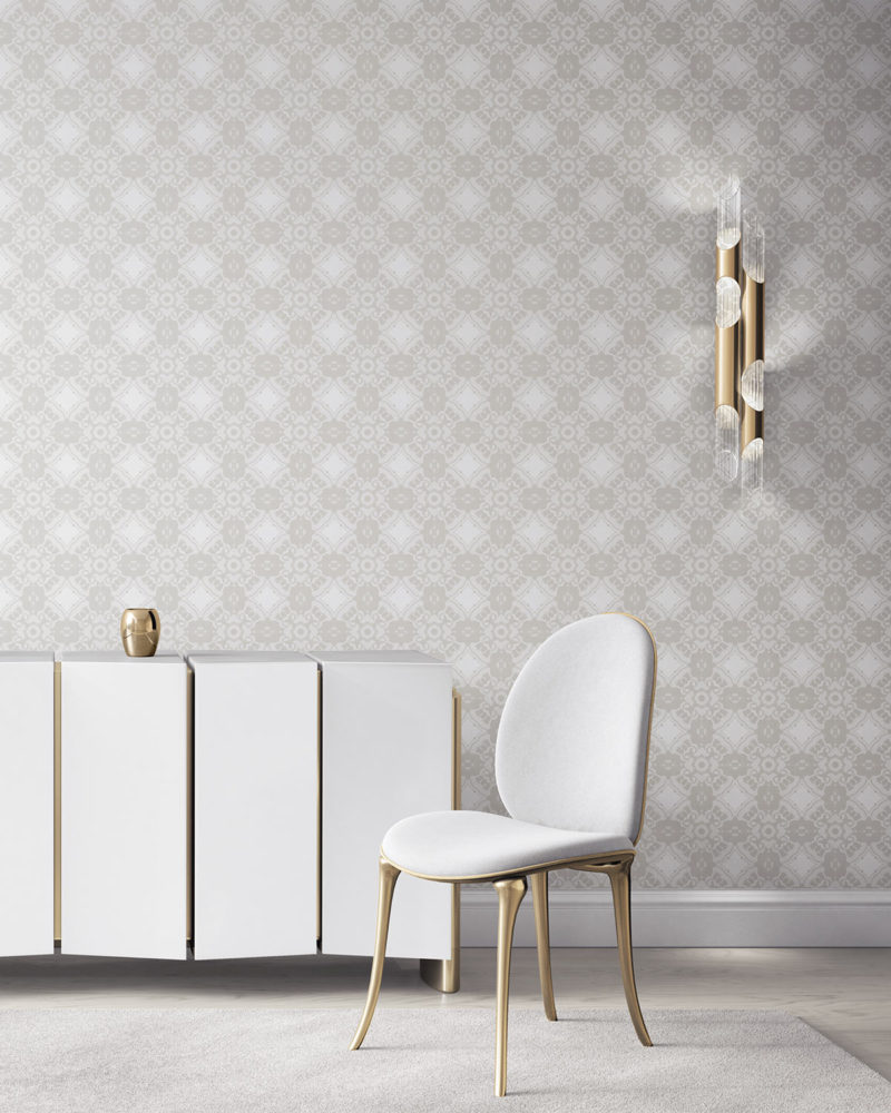 Pearl & Maude's Alexandria medallion prepasted wallpaper in neutral cream and white installed in a beautiful living room with white and brass furniture.