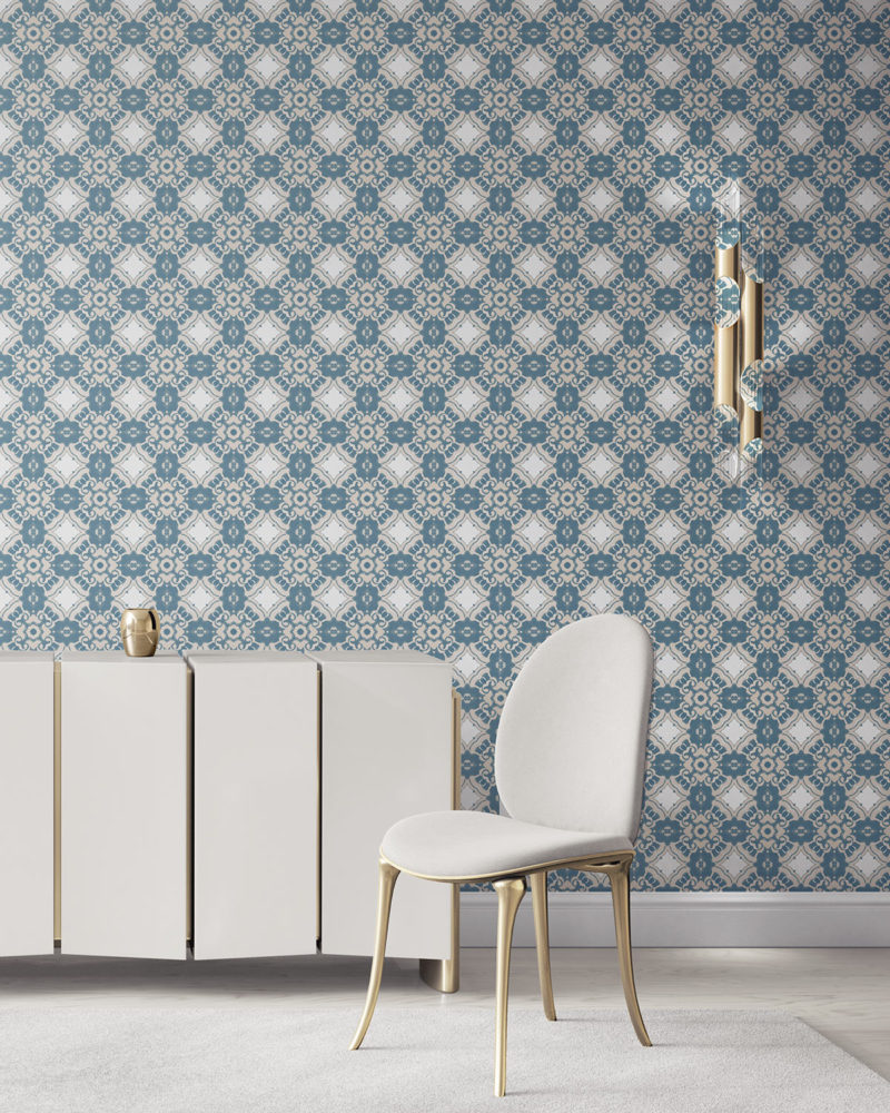Pearl & Maude's Alexandria medallion prepasted wallpaper in sea blue, cream and white installed in a beautiful living room with white and brass furniture.