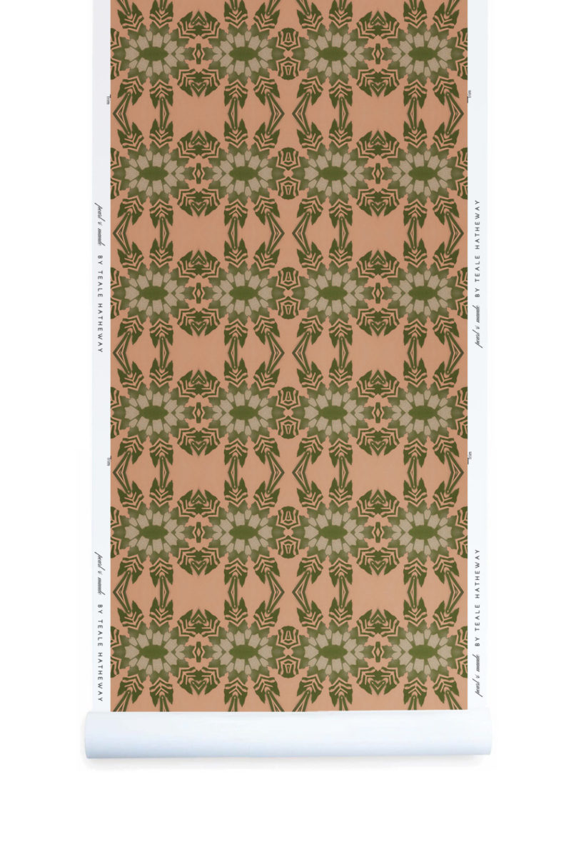 A roll of Pearl & Maude's tropical botanical Artemis nonwoven vellum wallpaper in dark clay pink and moss green