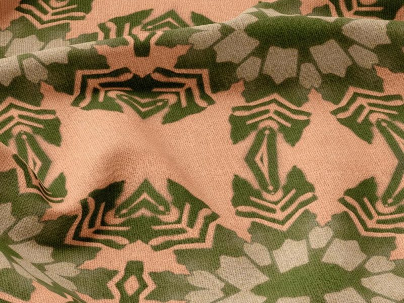 A fabric swatch of Pearl & Maude's tropical botanical pattern Artemis in dark clay pink and moss green