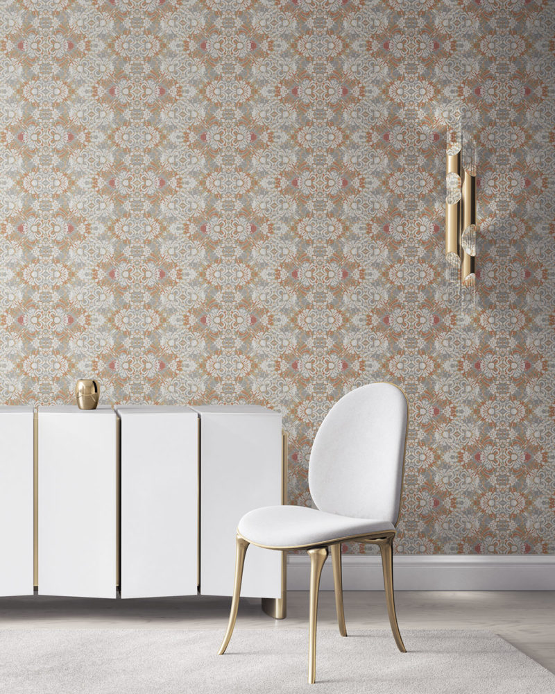 Pearl & Maude's abstract botanical Carmen grasscloth wallcovering in clay pink and grey installed in a beautiful living room with white and brass furniture.