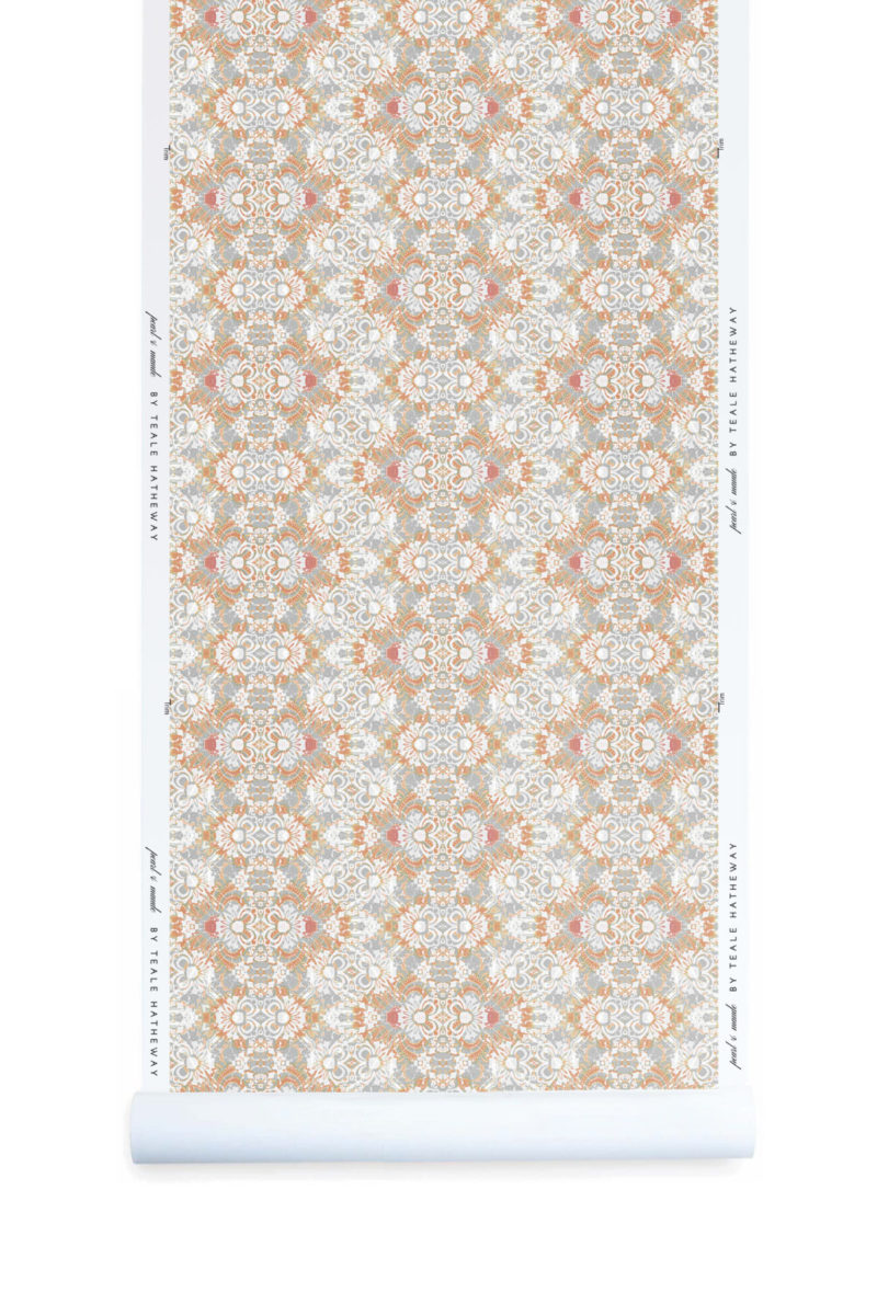A roll of Pearl & Maude's abstract botanical Carmen nonwoven vellum wallpaper in clay pink, white and grey