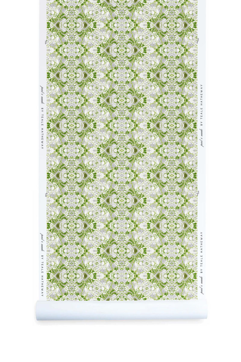 A roll of Pearl & Maude's abstract botanical Carmen nonwoven vellum wallpaper in moss green, white and grey