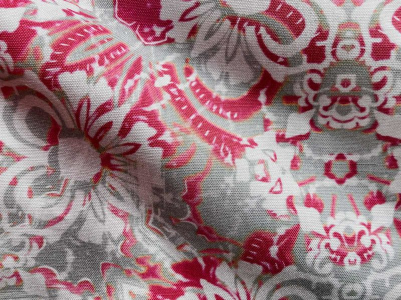 A fabric swatch of Pearl & Maude's abstract floral Carmen in berry magenta and grey