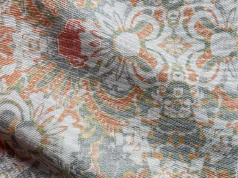 A fabric swatch of Pearl & Maude's abstract floral Carmen in clay pink and grey