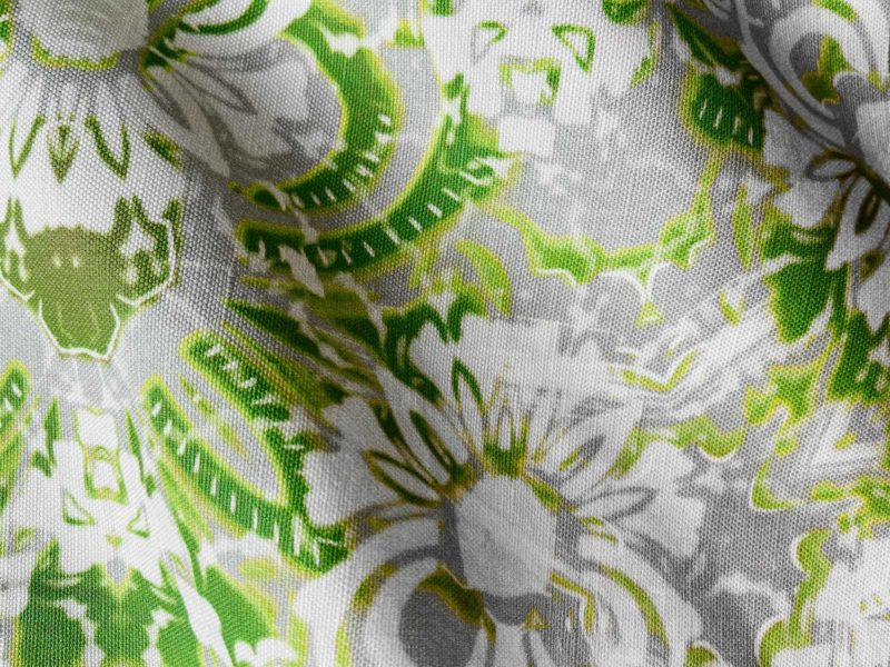 A fabric swatch of Pearl & Maude's abstract floral Carmen in moss green and grey