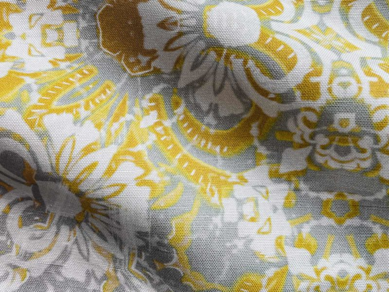 A fabric swatch of Pearl & Maude's abstract floral Carmen in daisy yellow and grey