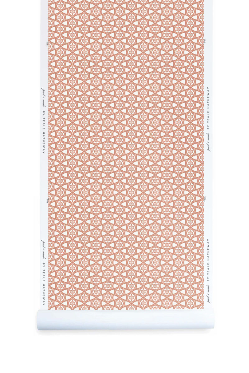 A detail swatch Pearl & Maude's small hexagon Cora nonwoven wallpaper in pink and white