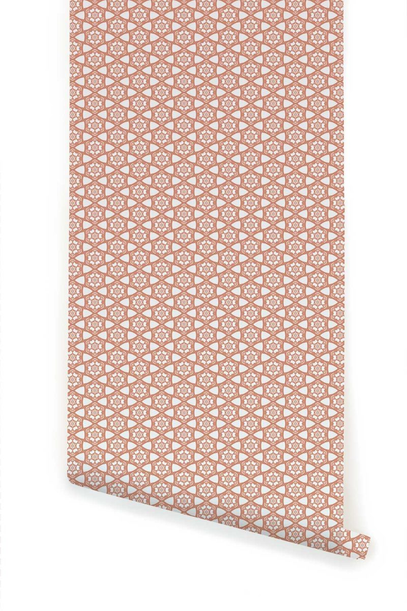 A detail swatch Pearl & Maude's small hexagon Cora prepasted wallpaper in pink and white