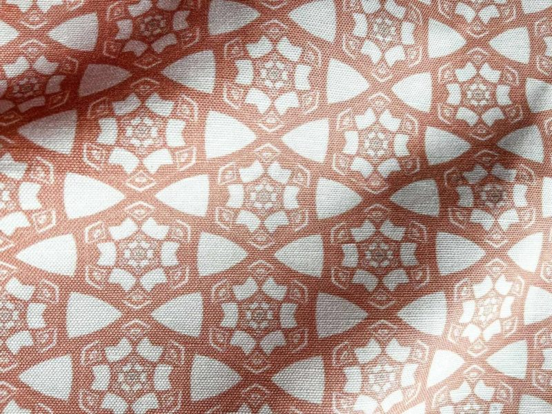 A fabric swatch of Pearl & Maude's small hexagonal pattern Cora in pink and white