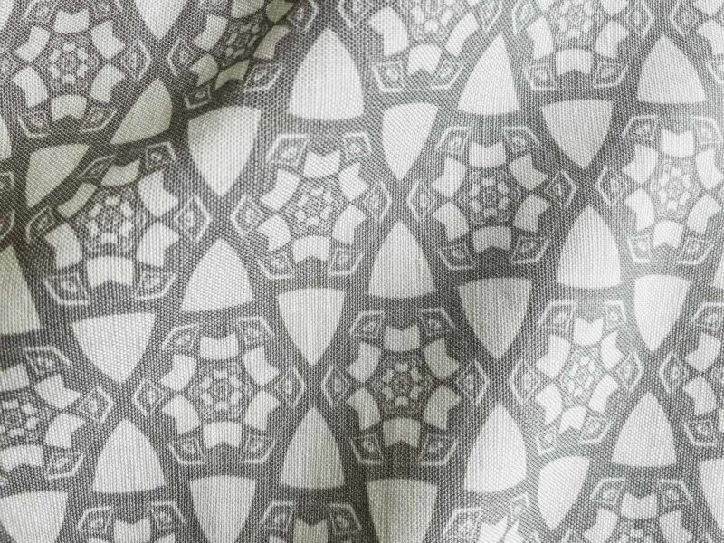 A fabric swatch of Pearl & Maude's small hexagonal pattern Cora in grey and white