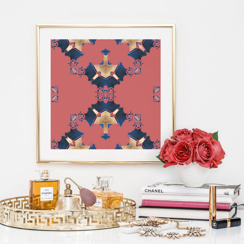 Eva is a square, pink and navy blue art print. The design was inspired by Art Deco architecture. Here, Eva is seen framed, with flowers