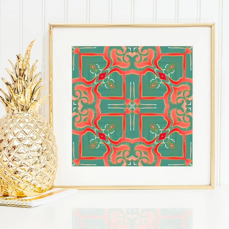 Mallorca is a coral red, peach and turquoise art print reminiscent of Mediterranean tile patterns. Here, Mallorca is framed and hanging on a wall.
